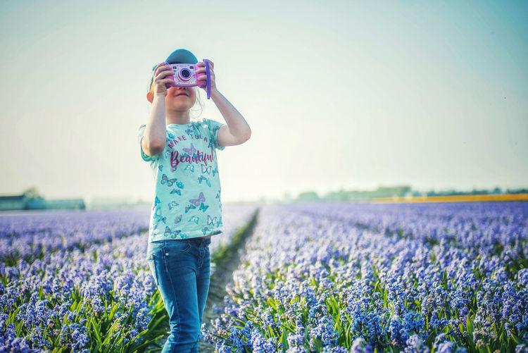 Full length of a girl standing on field