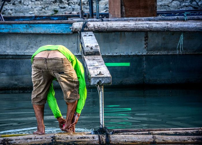 Water One Man Only Only Men Outdoors One Person Day Occupation Adult Spraying Adults Only Men Cleaning Standing People Real People Full Length Nautical Vessel Working City Mammal EyeEmNewHere Lifestyles Manila Philippines EyeEm Best Shots EyeEm Gallery