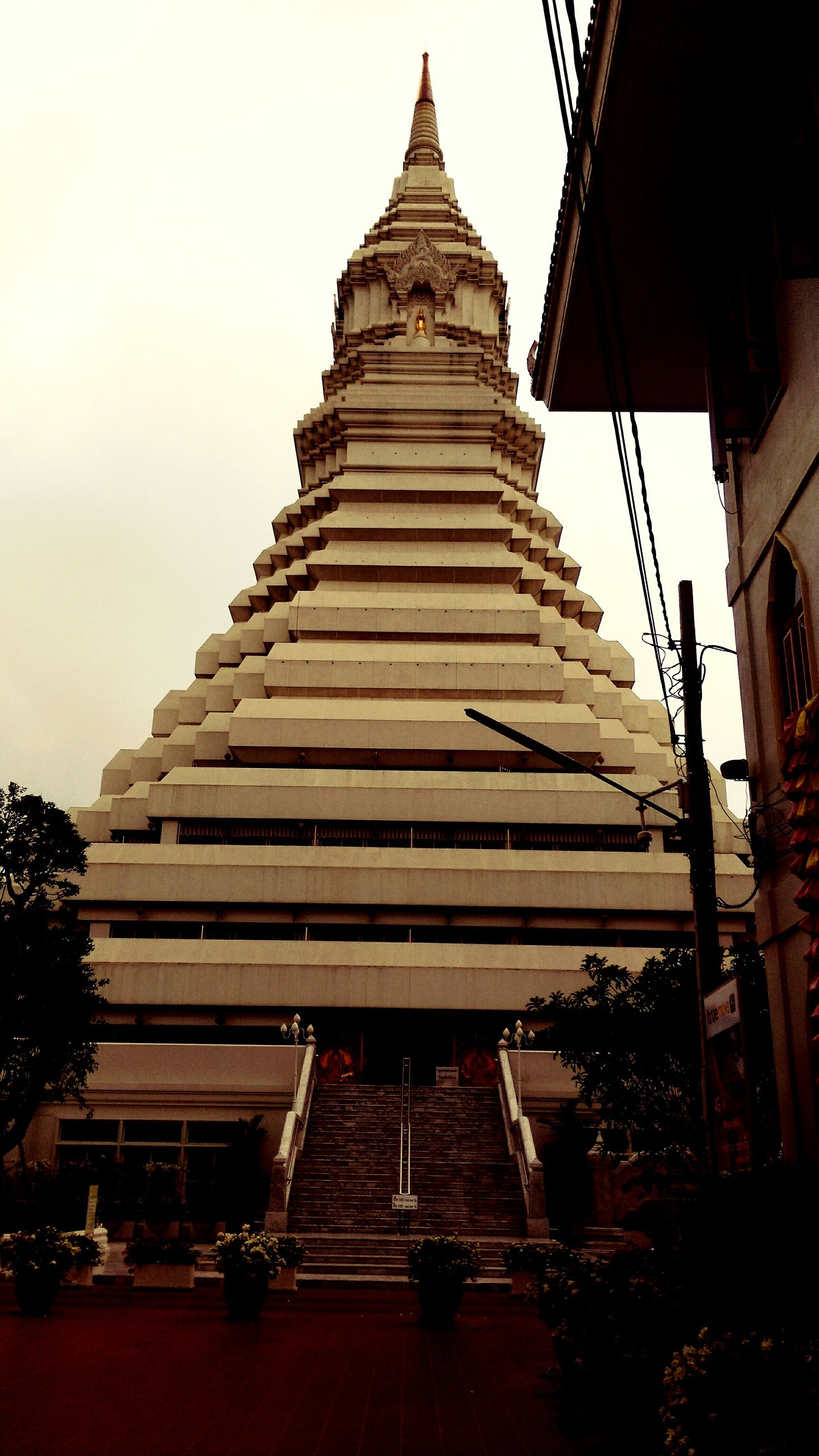 architecture, built structure, building exterior, low angle view, place of worship, temple - building, religion, famous place, spirituality, clear sky, history, travel destinations, travel, international landmark, tourism, sky, temple, outdoors, cultures