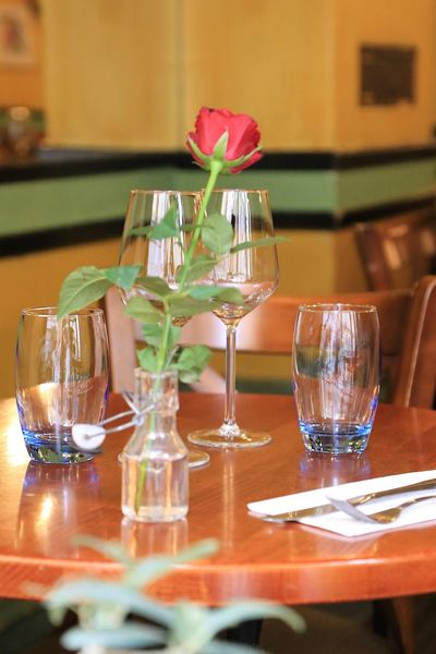 On The Table One Rose Rose Flower Interior Views Interior Design Table Restaurant Decor Restaurant Scene Decoration Decorations Table Glass Freshness Setting Drinking Glass Flower Restaurant Food And Drink Furniture Business Glass - Material Wineglass Household Equipment Flowering Plant Plant Indoors  Nature Vase Place Setting Arrangement