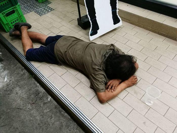 sleeping man Floor Sleeping One Person Sleeping Night Drunk Drunk Nights Low Section Men Lying Down Sidewalk High Angle View