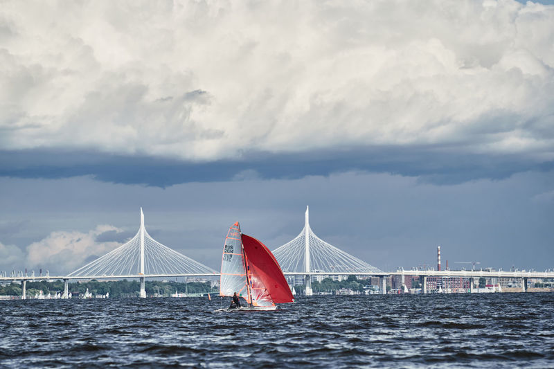 View of bridge over sea against cloudy sky