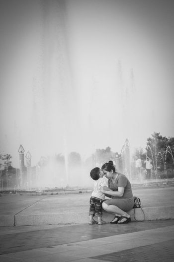 Mother with son against fountain