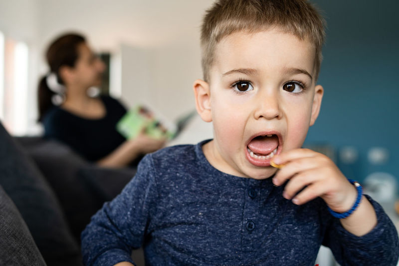 Child Focus On Foreground Men Childhood Boys Males  Real People Portrait Front View Indoors  Headshot Home Interior Lifestyles Emotion Casual Clothing Innocence Mouth Open Mouth Making A Face