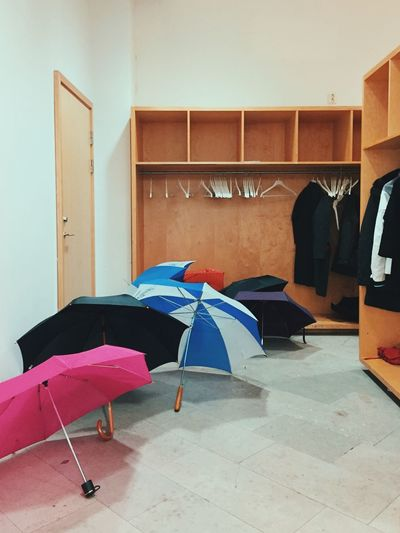 Umbrellas And Coats In Mudroom At Home
