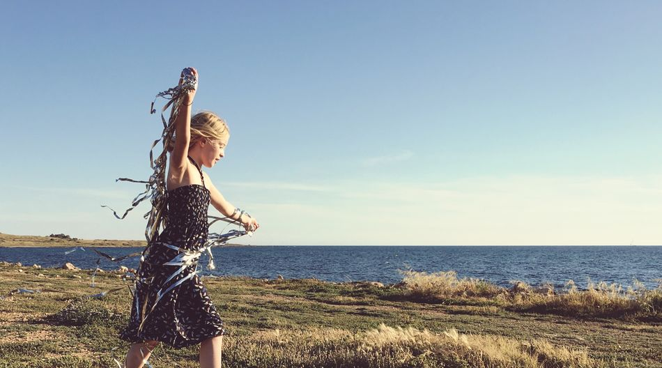 Greece Sea And Sky Grass Silver  Dress Girl Power Blue Sky Sunny Sky Water Sea Nature One Person Horizon Over Water Horizon Sunlight Beauty In Nature Leisure Activity Real People Lifestyles Scenics - Nature