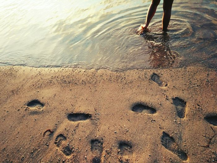 foot prints by the beach Low Section Water Beach Sand Human Leg Close-up Sky FootPrint Shore Sandy Beach barefoot