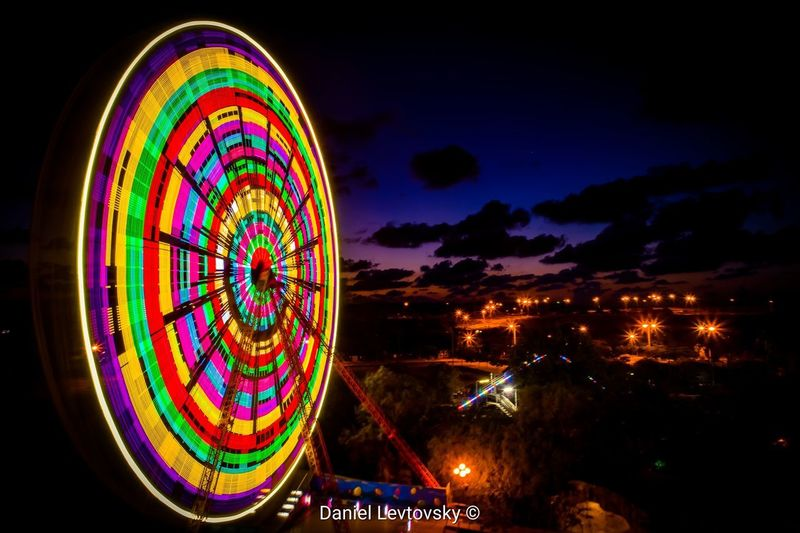My version of a lollipop City Cityscape Illuminated Multi Colored Gambling Ferris Wheel Urban Skyline Arts Culture And Entertainment Neon Amusement Park Ride