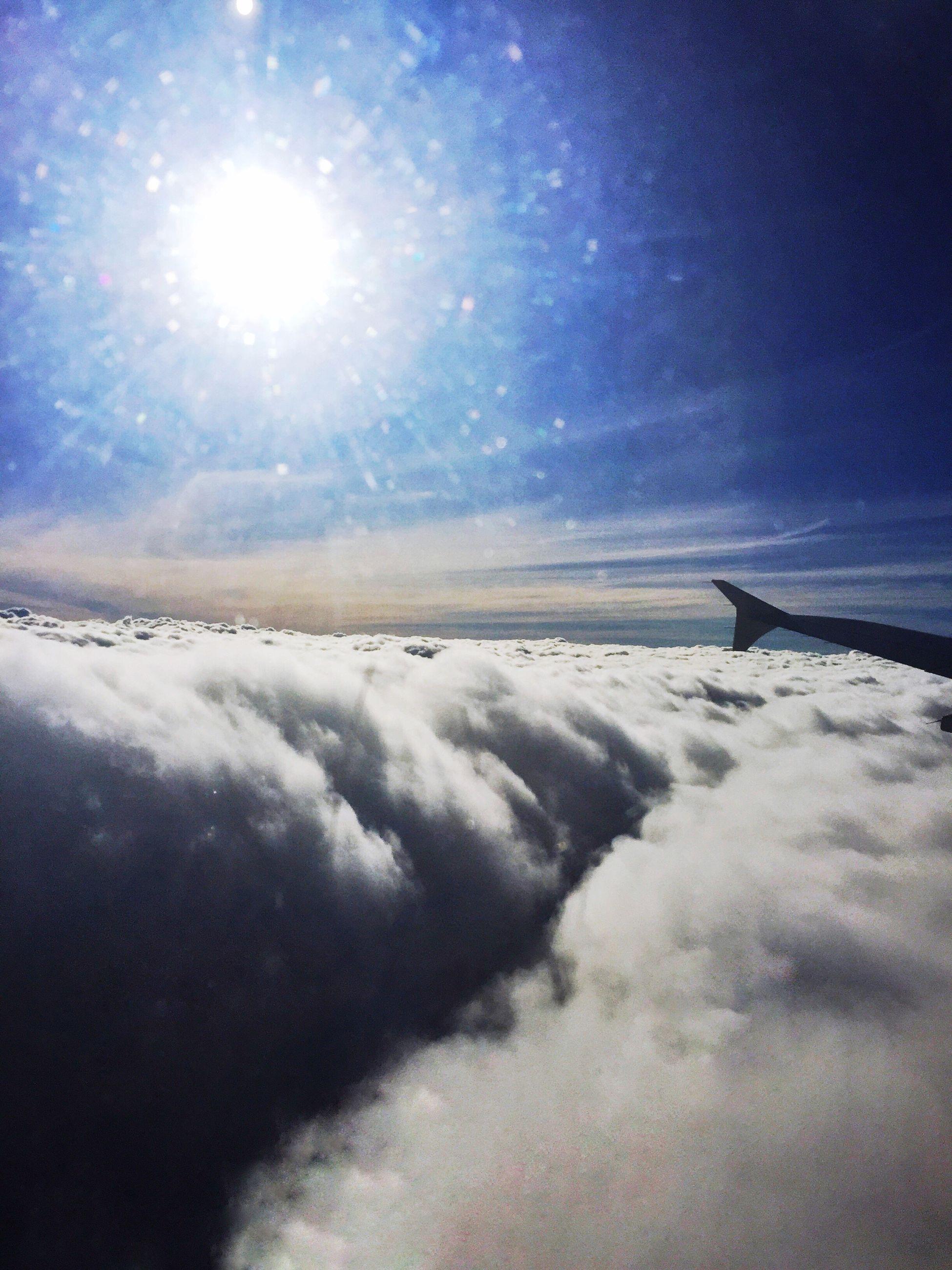sky, sun, beauty in nature, scenics, tranquil scene, tranquility, cloud - sky, nature, sunbeam, weather, sunlight, blue, snow, winter, cloudscape, cold temperature, cloud, idyllic, lens flare, cloudy