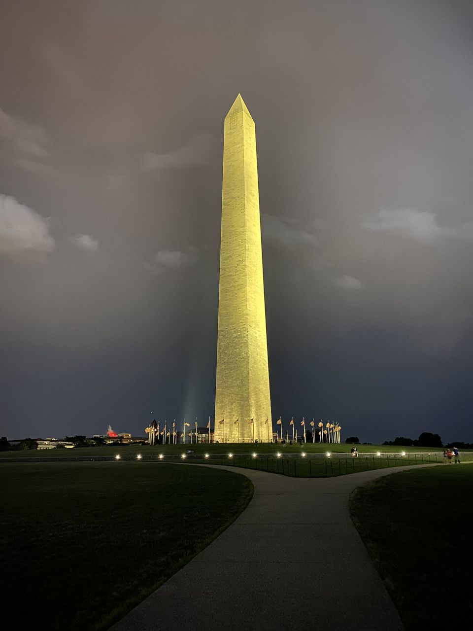 MONUMENT AGAINST CLOUDY SKY