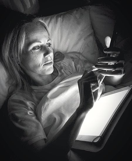 Portrait of woman relaxing on bed at home