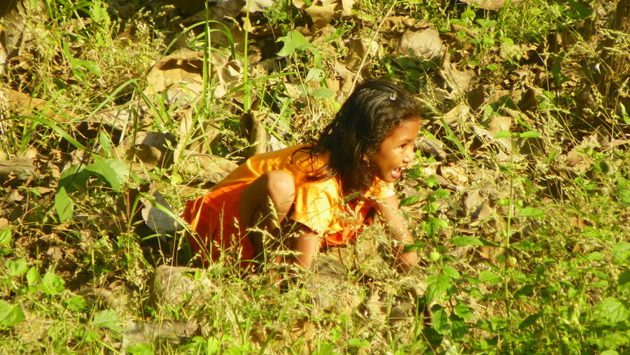 Cool little girl waiting for some pray. Child Childhood Children Day EyeEmNewHere Field Girl Happiness INDONESIA Long Hair One Person People Playing Real People Sitting