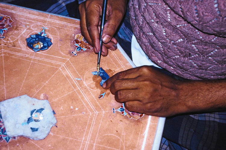 Precious stones being inlaid into a table - Agra, India Agra - India Maharani Jewels Precious Stone Inlays Adult Adults Only Art And Craft Close-up Day Human Body Part Human Hand Indoors  Men One Person Only Men People Precious Stones Real People Working Business Stories EyeEmNewHere A New Beginning Holiday Moments