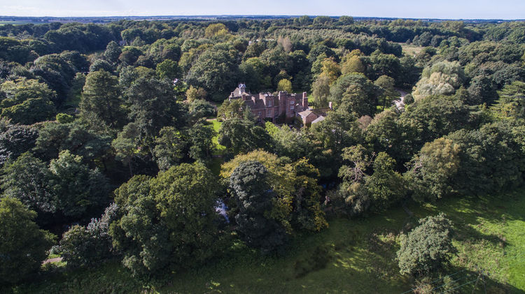 Rufford Old Hall English Country House hidden in the trees Aerial View Architecture Autumn Trees Beauty In Nature Building Exterior Built Structure Day Drone Photography Green Color Growth Lancashire UK Lush Foliage Nature No People Old English House Outdoors Rufford Old Hall Scenics Sky Tranquil Scene Tranquility Tree