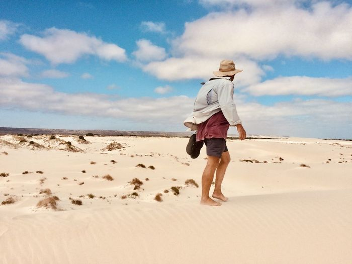 EyeEmNewHere Scorching Heat Australia & Travel Figure In Nature Heat - Temperature Lost In The Desert Man Walks Alone Remote Places Sand Dune Skin Cancer