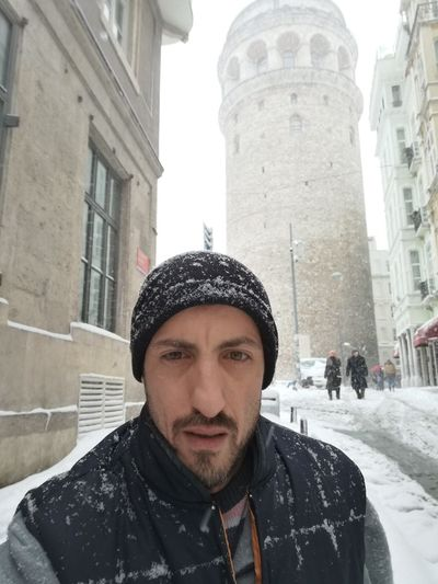 Only Men One Man Only Adults Only Headshot Beard City One Person Adult Portrait Building Exterior People Architecture Men Outdoors Young Adult Day Snow ❄ Huawei P9 Leica Galata Tower Galatakulesi Natural Beauty City Sky Winter Reflection
