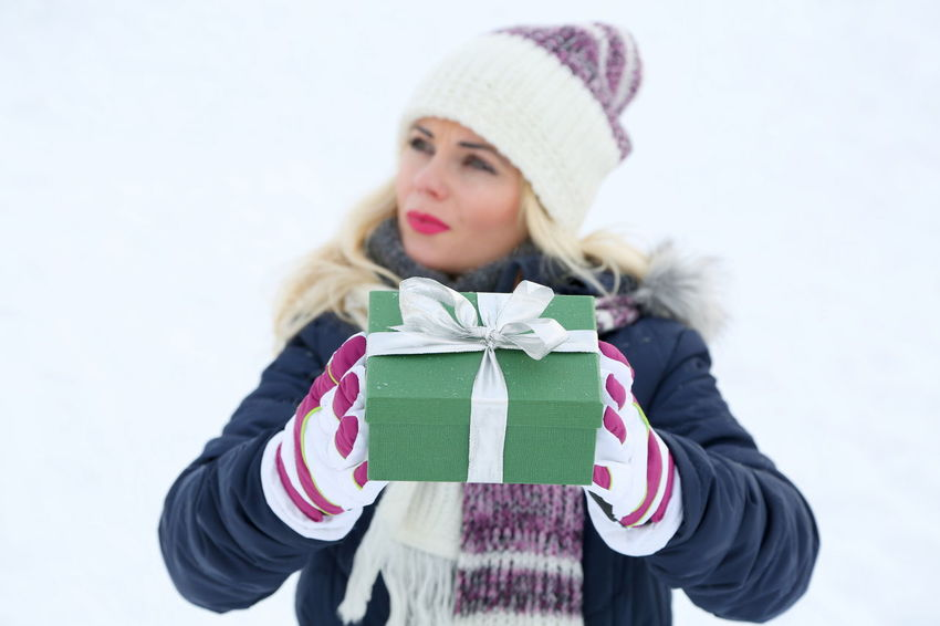 Adult Blond Hair Celebration Christmas Christmas Present Cold Temperature Gift Giving Glove Holding Knit Hat Love Outdoors Portrait Snow Surprise Valentine's Day  Warm Clothing Winter Wintertime Young Woman Uniqueness The Portraitist - 2017 EyeEm Awards