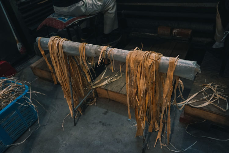 High angle view of wooden shavings on stand at workshop