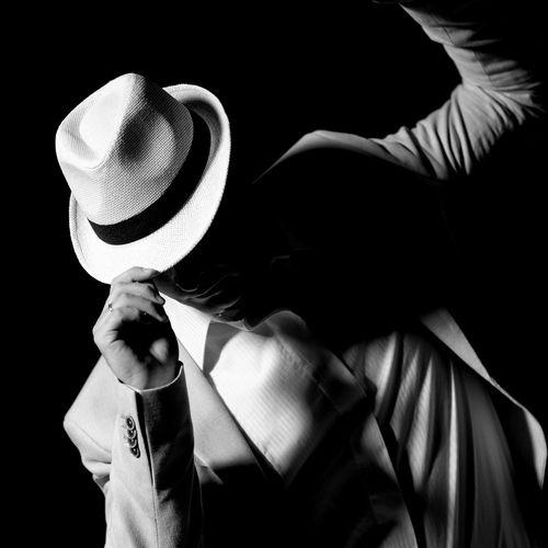 Tilt image of man dancing against colored background