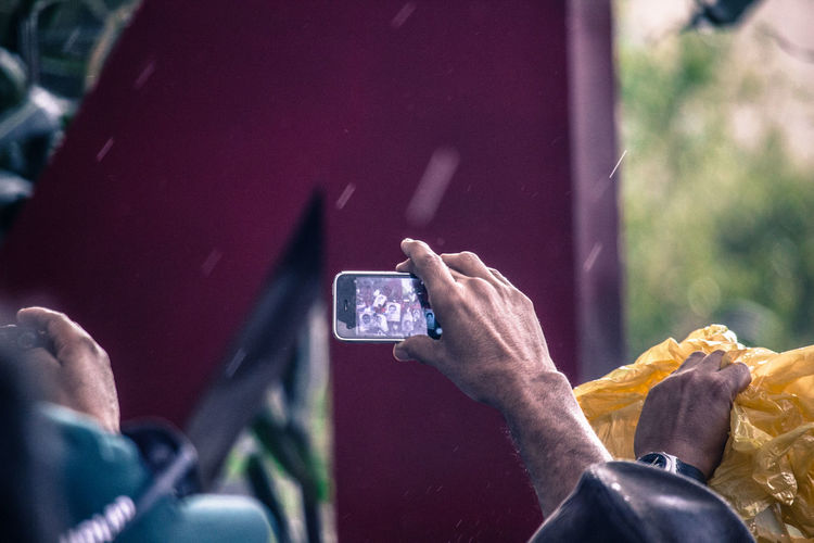 Close-up of man photographing with mobile phone