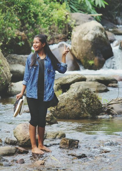 Water Full Length Young Women Women Standing Happiness Smiling Rock - Object Casual Clothing Stream - Flowing Water Ankle Deep In Water Flowing Water Flowing Stream Moss Waterfall Shallow River Power In Nature Fountain Dam Thoughtful