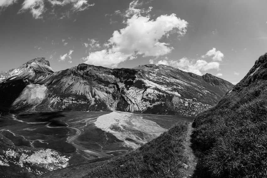 Swiss Alps / galery BW edit - captured near Flims at UNESCO World Heritage Site Sardona - (c) Nidal Sadeq Earth Fine Art Photography Hiking Segnesboden Wanderlust Beauty In Nature Blackandwhite Day Flims Geological Formation Geology Hiking Trail Meander Mountain Nature No People Outdoors Scenics Sky Swiss Alps Tranquil Scene Tranquility Travel Destinations Water