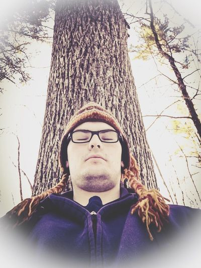 Finding New Frontiers Real People Lifestyles One Person Headshot Front View Tree Head And Shoulders Leisure Activity Young Adult Low Angle View Mid Adult Men Tree Trunk Eyeglasses  Men Sitting Meditation OutdoorssBare TreeeGlassessDayyNaturee