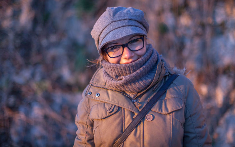 Clothing Warm Clothing Portrait Winter One Person Autumn Looking At Camera Adult Front View Scarf Focus On Foreground Hat Young Adult Standing Knit Hat Fashion Cold Temperature Day Outdoors Winter Coat Hairstyle Hood - Clothing