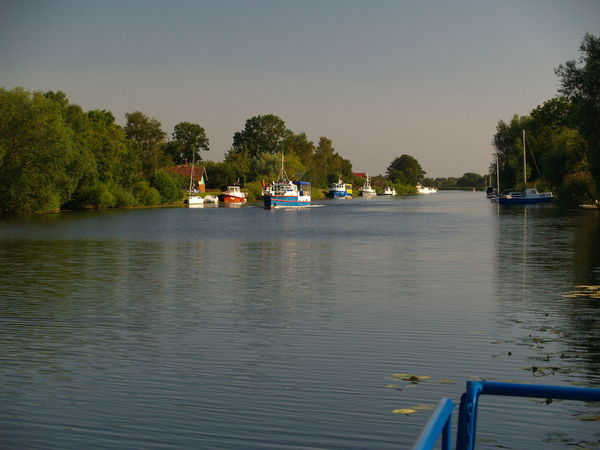 Mingė is the Village where the rivew flows in the place of the central street dividing the village into two banks. Day Mode Of Transport Nature Nautical Vessel No People Outdoors Sailing Sky Tranquil Scene Transportation Water Waterfront