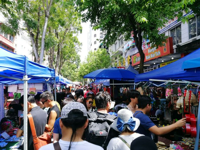 Large Group Of People Market Men Women Crowd Retail  Leisure Activity Adults Only Built Structure People Architecture Market Stall Customer  Tree City Buying Adult Outdoors Day