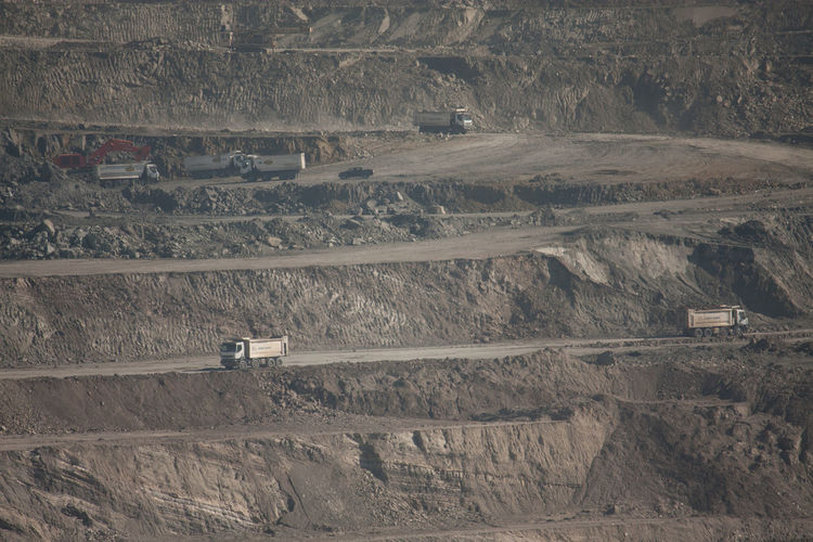 Trucks At Layers Of Opencast Mine