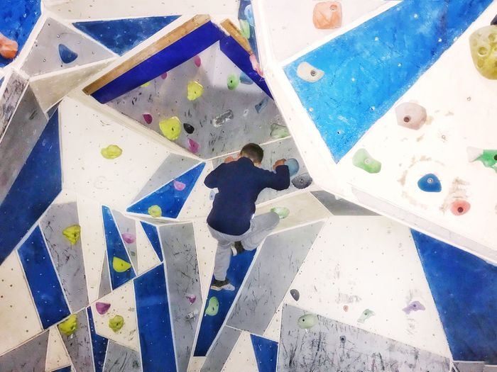 You can do it Indoor Activities Boy Bouldering His Way To The Top Bouldering Eye Em Gallery Keeping Active Clubs Climbing Climbing Wall Leisure Activity High Angle View Sport Exercising Challenge One Person Lifestyles Skill  Strength Healthy Lifestyle Extreme Sports Real People Be Brave