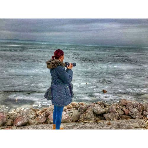 Ice Ice Winter Beach Warm Clothing Water Lake Balaton Siofok Hungary Casual Clothing One Person Outdoors People Full Length Rear View Sea Standing Real People Day Beauty In Nature Nature Wave Sky Adults Only Adult