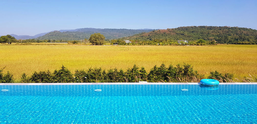 Scenic view of swimming pool against blue sky