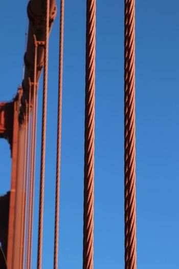Close-Up Of Railing Against Blue Sky