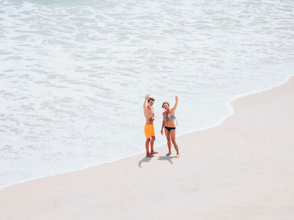 hi thereee Beach Sand Two People Waving