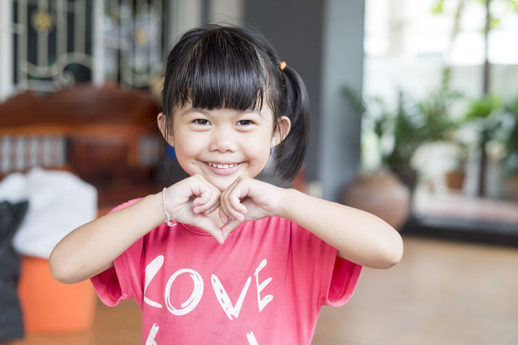the eyes of love Bangs Casual Clothing Child Childhood Cute Emotion Females Focus On Foreground Front View Girls Hairstyle Happiness Innocence Lifestyles Looking At Camera One Person Portrait Real People Smiling Waist Up Women