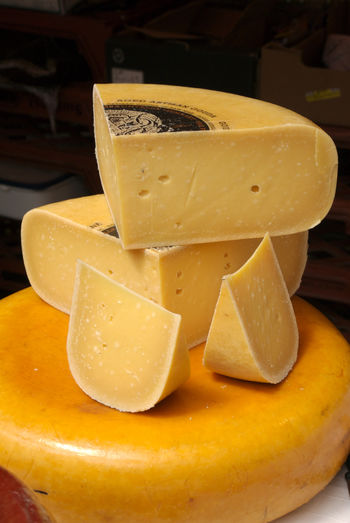 Agriculture Artisan Cheese Cheese Wheel Cheese! Close-up Dairy Dairy Products Farmer's Market Focus On Foreground Food Freshness Hard Cheese Indulgence Market No People Orange Color Roll Still Life Wedges Wheel Yellow