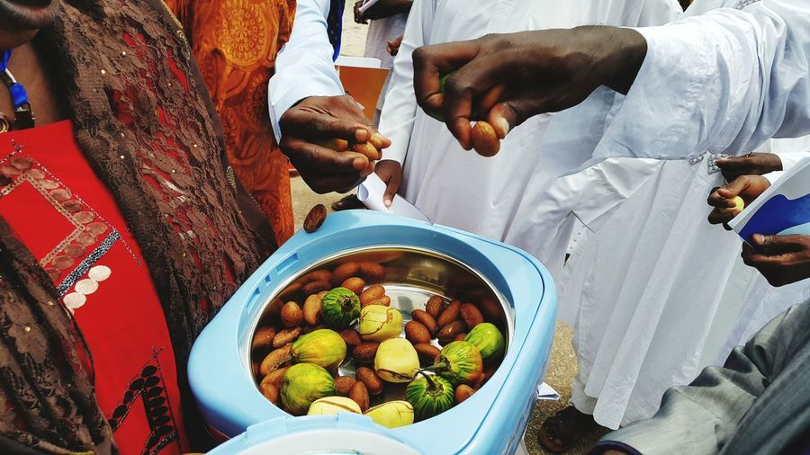 High Angle View Of People With Kola Nuts