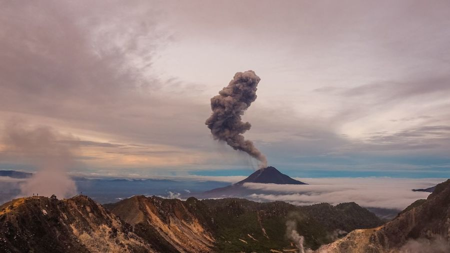 Gunung Sinabung Volcano eruptions INDONESIA Medan Sinabung Active Volcano Ash Beauty In Nature Cloud - Sky Dawn Day Emitting Erupting Eruption Fog Geology Gunung Landscape Mist Mountain Nature No People Outdoors Physical Geography Power In Nature Scenics Sky Smoke - Physical Structure Tranquility Volcano