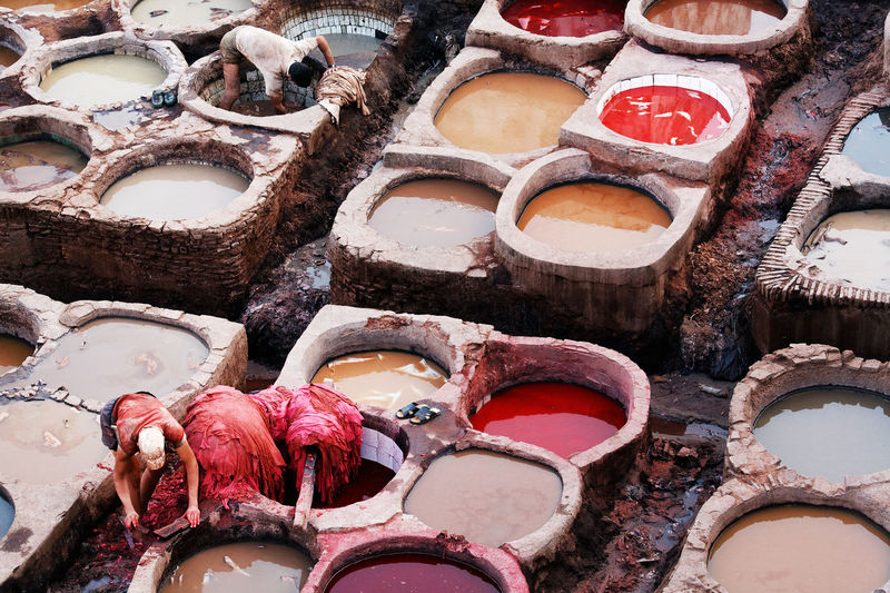 High angle view of people working at tanneries