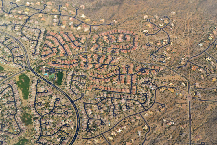 Aerial view of suburban sprawl of residential housing developments in the Phoenix, Arizona area Aerial Aerial Shot Aerial View Agriculture Arizona Backgrounds Beauty In Nature Day Golf Course Housing Landscape Nature Neighborhood No People Outdoors Phoenix Residential Building Residential Housing Scenics Tourism Travel Destinations Drone  Desert Beauty Construction High Angle View