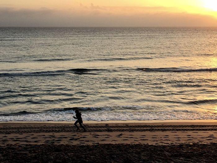 Running at sunrise on the atlantic shore
