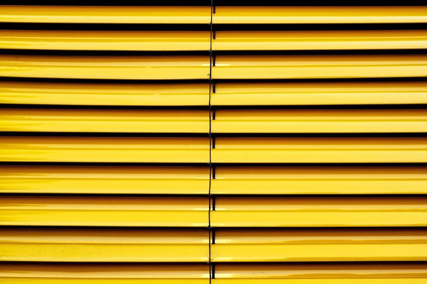 Urban Perspectives The Devil's In The Detail Urban Geometry Architectural Detail Urban Photography Summer In The City Streetphoto_color Architectural Feature No People Architectural Design Backgrounds Yellow Blinds Full Frame Corrugated Iron Pattern Striped Close-up Symmetry Parallel Repetition Shutter Closed