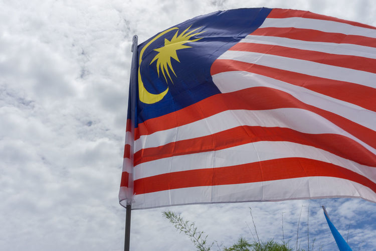 Malaysia flag waving in the air Day Flag Low Angle View No People Outdoors Patriotism Red Sky Stars And Stripes Striped