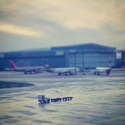 Watching the hustle and bustle of airport runways does make you feel like you're looking in on a miniature world. Manchesterairport