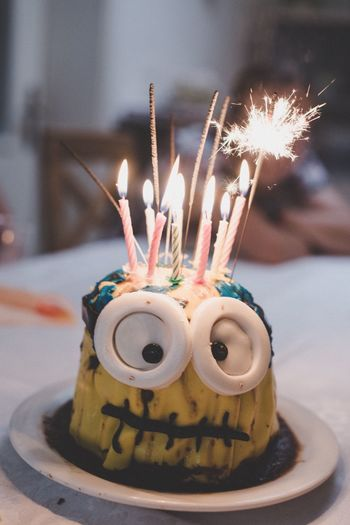 EyeEm Selects Celebration Indoors  Food And Drink Burning Focus On Foreground Food Cake Birthday Candles Sparkler Birthday Close-up Dessert Plate No People Sweet Food Birthday Cake Freshness Ready-to-eat Day Minions Cakes Party Food Stories