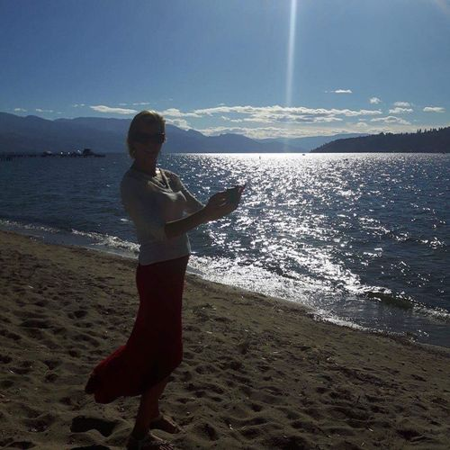 Okanagan Lake sparkling water Portrait Of A Woman Outdoors Nature EyeEm Mountain Lakeshore Beach Photography Taking Pictures Sunlight Reflection Waterfront Sunbeamsthroughthesun Sunlight Sparkling Water Sparkle The Week On EyeEm Horizon Over Water