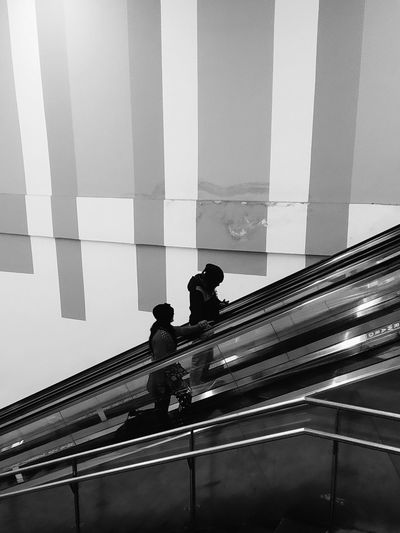 Low angle view of people on staircase against building