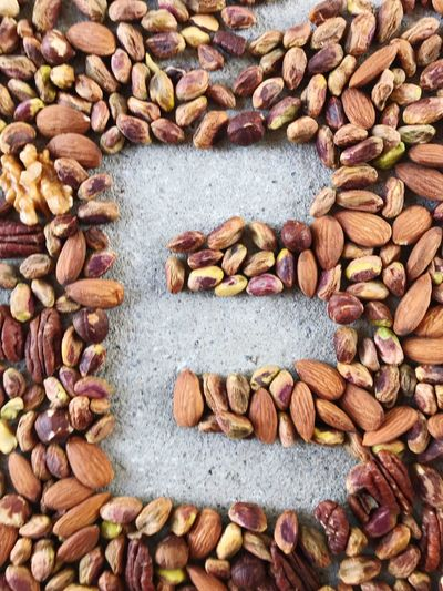 Capital letter E hole from almonds, pistachios, hazelnuts, pecan nuts and walnuts on concrete floor Letter E Capital Letter Alphabet Healthy Eating Pecan Nuts Roasted Almonds Walnuts Pistachio Healthy Food Concept Variety Of Nuts Mock Up EyeEm Selects Large Group Of Objects Abundance Nut Nut - Food Backgrounds No People Food And Drink Full Frame Food High Angle View Choice Wellbeing Variation Freshness Healthy Eating Almond Day Collection
